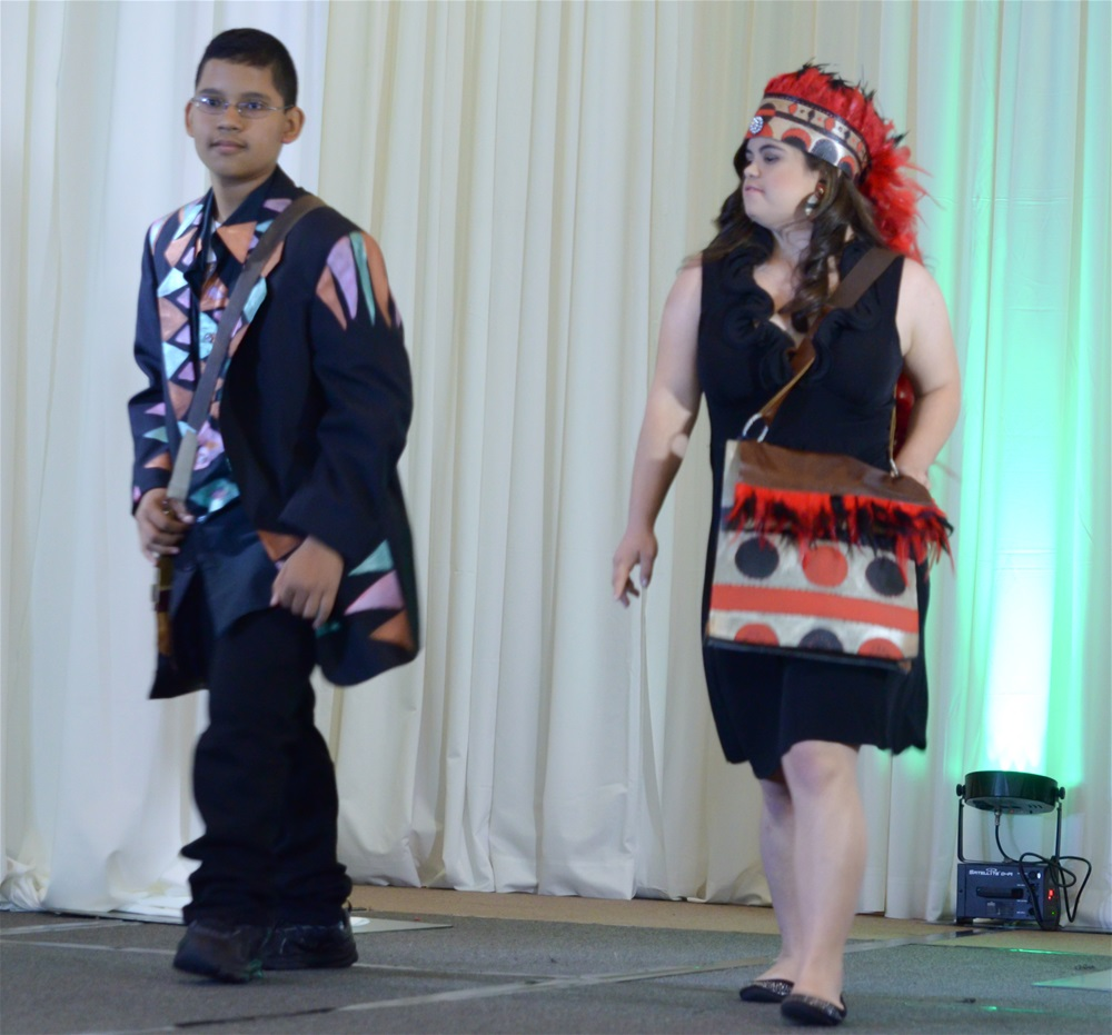 A male and female model in a Native American outfit