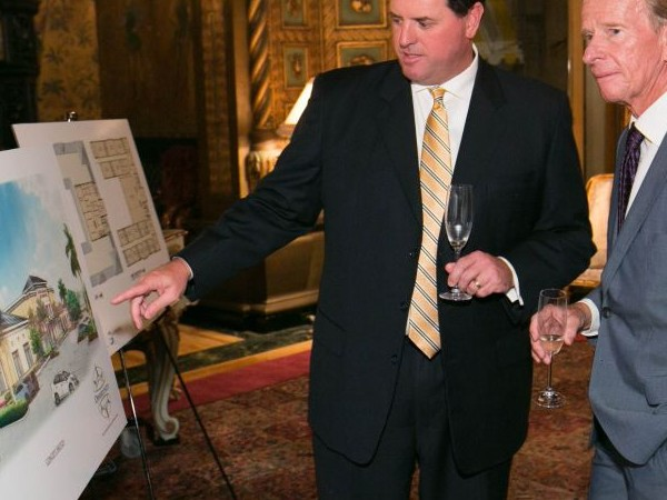 Board President Pete Nicoletti shows plans to Claes Bjork.